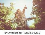 boyfriend carries the girl on... | Shutterstock . vector #653664217
