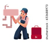 plumbing specialist with wrench ... | Shutterstock .eps vector #653688973