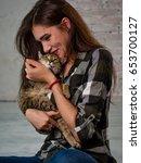 girl hugging a cat. love ...   Shutterstock . vector #653700127