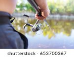 fishing spinning in the hand... | Shutterstock . vector #653700367