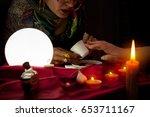 fortune teller read a fortune... | Shutterstock . vector #653711167