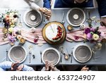 newlywed couple hands cutting... | Shutterstock . vector #653724907