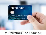hand holding plastic credit card | Shutterstock . vector #653730463