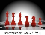 red chess figures on board in... | Shutterstock . vector #653771953