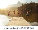 group of young people jumping... | Shutterstock . vector #653792767