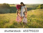 family portrait of mother with... | Shutterstock . vector #653793223