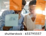 two business professionals... | Shutterstock . vector #653795557