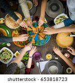 table of enjoying food with... | Shutterstock . vector #653818723