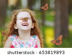 Stock photo funny laughing curly girl with a butterfly on his nose healthy smile with white teeth free 653819893
