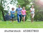 happy family outdoors  | Shutterstock . vector #653837803