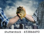 handshake against city... | Shutterstock . vector #653866693
