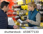 female hardware store seller... | Shutterstock . vector #653877133