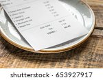 paying check for lunch with... | Shutterstock . vector #653927917