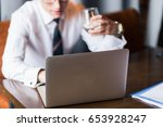 man working with laptop in... | Shutterstock . vector #653928247