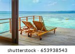 Two Wooden Lounge Chairs On Th...