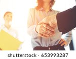 business people shaking hands.... | Shutterstock . vector #653993287