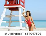 sexy woman  in red swimsuit... | Shutterstock . vector #654047503