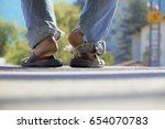 to wander  a vagrant sitting on ... | Shutterstock . vector #654070783