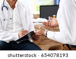 male medicine doctor with... | Shutterstock . vector #654078193