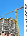 crane and building under... | Shutterstock . vector #654097003