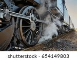 steam locomotive rolling by... | Shutterstock . vector #654149803