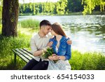 young couple in love outdoor... | Shutterstock . vector #654154033