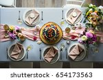 wedding reception table setting | Shutterstock . vector #654173563