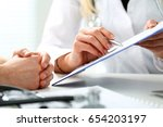 Small photo of Female doctor hand hold silver pen and showing pad. Physical agreement form signature, disease prevention, ward round reception, consent contract sign, prescribe remedy, healthy lifestyle concept