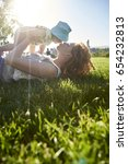 happy mother playing on green... | Shutterstock . vector #654232813