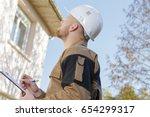 male contractor looking up... | Shutterstock . vector #654299317