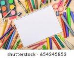 school supplies on wooden...   Shutterstock . vector #654345853
