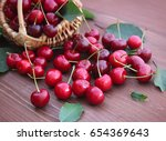 fresh juicy cherry on a wooden... | Shutterstock . vector #654369643