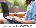 female hands typing on a laptop ... | Shutterstock . vector #654377623