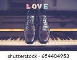 Grooms Shoes On Piano