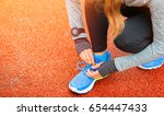 athletic woman with smart watch ... | Shutterstock . vector #654447433
