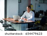 attentive businessman working... | Shutterstock . vector #654479623