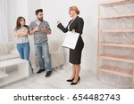 real estate scammers with an... | Shutterstock . vector #654482743