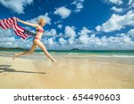 patriotic smiling woman with... | Shutterstock . vector #654490603