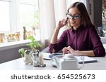 woman at the cafeteria speak on ... | Shutterstock . vector #654525673