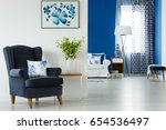 blue armchair and vase with...