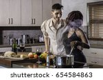 young mixed race couple cooking ... | Shutterstock . vector #654584863