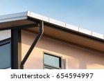 rain gutter of roof with... | Shutterstock . vector #654594997