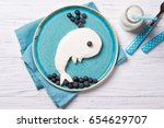 funny toast in a shape of whale ... | Shutterstock . vector #654629707