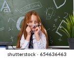 schoolgirl in glasses on a... | Shutterstock . vector #654636463