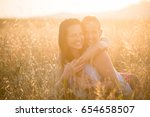 young cute daughter embracing... | Shutterstock . vector #654658507