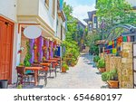 the cozy outdoor cafe in shady... | Shutterstock . vector #654680197