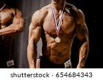 bodybuilder athlete gold medal... | Shutterstock . vector #654684343