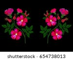 embroidery dog rose on a black... | Shutterstock .eps vector #654738013