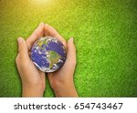 earth planet in asian children... | Shutterstock . vector #654743467