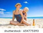 sun kissed beauty. smiling... | Shutterstock . vector #654775393
